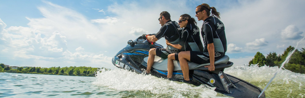 Three people riding a jetski